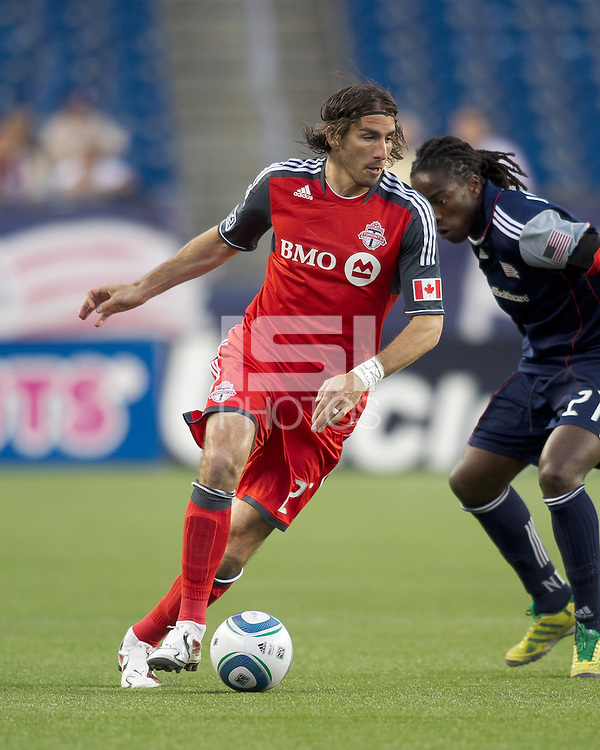 Toronto FC forward Alan Gordon (21) dribbles. In a Major League Soccer (MLS) match, the New England Revolution tied Toronto FC, 0-0, at Gillette Stadium on June 15, 2011.