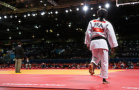 29 JUL 2012 - LONDON, GBR - Priscilla Gneto (FRA) of France walks onto the mat for the start of her women's -52kg category repechage contest against Kyung-Ok Kim (KOR) of South Korea in the London 2012 Olympic Games judo at the ExCel Exhibition Centre in London, Great Britain (PHOTO (C) 2012 NIGEL FARROW)