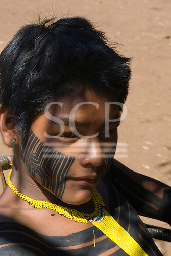 Pará State, Brazil. Aldeia Kokraimoro (Kayapo). A young warrior with ear pierced and face and body paint.
