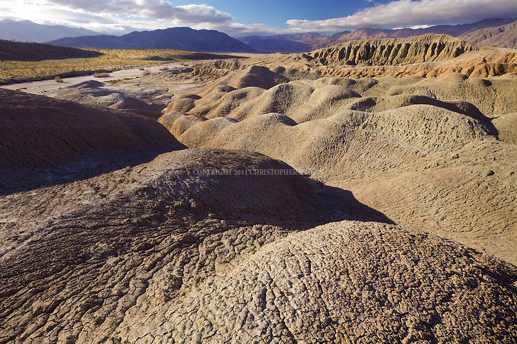 Mudhills created by centuries of erosion. Anza-Borrego Desert State Park (Est. May 1948), largest state park in California 600,000 acres (2,400 km2); second-largest in continental US. Five hundred miles of dirt roads, 12 wilderness areas. Park named for Spanish explorer Juan Bautista de Anza and the Spanish word borrego, or bighorn sheep. San Diego County, CA.