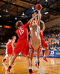 BROOKING, SD - NOVEMBER 13:  Macy Miller #12 from South Dakota State takes the ball to the basket between Kendall Babb #15 and Allie Clement #4 form Marist in the second half of their game Friday night at Frost Arena in Brookings. (Photo by Dave Eggen/Inertia)