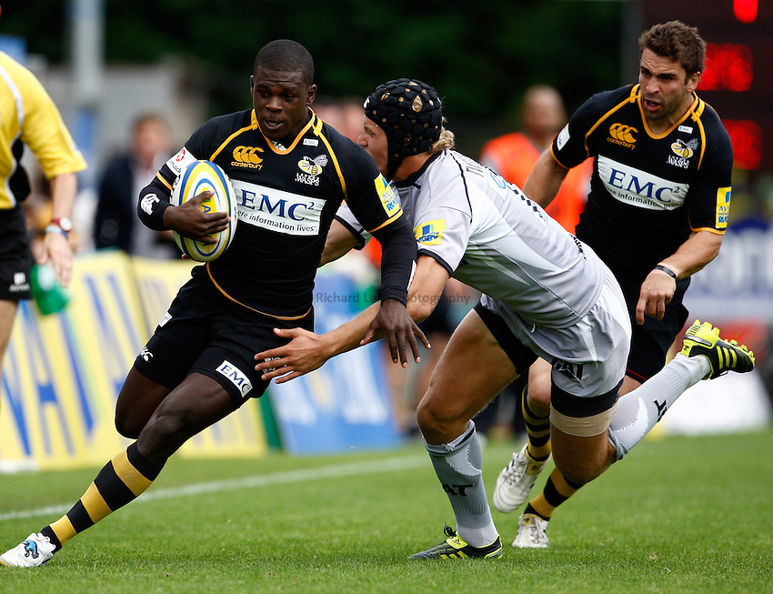 Photo: Richard Lane/Richard Lane Photography. London Wasps v Leicester Tigers. 11/09/2011. Wasps' Christian Wade is tackled by Tigers' Billy Twelvetrees