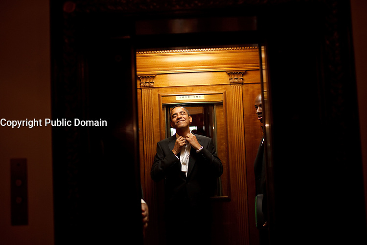 Early in the morning on Jan. 21st, President Barack Obama rides the elevator to the Private Residence of the White House after attending 10 inaugural balls and a long day including being sworn in as President at noon on Tuesday, Jan. 20, 2009. <br /> Official White House Photo by Pete Souza