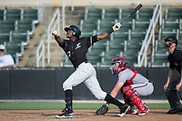 Micker Adolfo (27) of the Kannapolis Intimidators follows through on his swing against the Hagerstown Suns at Kannapolis Intimidators Stadium on June 15, 2017 in Kannapolis, North Carolina.  The Intimidators walked-off the Suns 5-4 in game one of a double-header.  (Brian Westerholt/Four Seam Images)