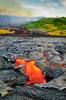 A large lava flow cuts Royal Gardens subdivision in half and flows towards the ocean, Kilauea volcano, east of Hawaii, USA Volcanoes National Park, Big Island of Hawaii, USA