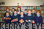 Pupils at Faha National School are working on numerous initiatives to get their fourth green flag among them building their own 'Green car' using recyclable materials. .Pictured  are the Green School Committee with representatives from each class who co-ordinate this year's Green initiatives.Back L-R Aileen O'Leary, Shannon Tagney, Sinead O'Sullivan, Niall Kennedy and Sean Buchanan.Front L-R Aaron Flynn, Conor O'Shea, Shona Mangan, Paudie Horgan and Laura Whelton