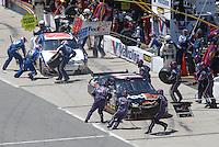 May 6, 2007; Richmond, VA, USA; Nascar Nextel Cup Series drivers Denny Hamlin (11) and Scott Riggs (10) pit during the Jim Stewart 400 at Richmond International Raceway. Mandatory Credit: Mark J. Rebilas
