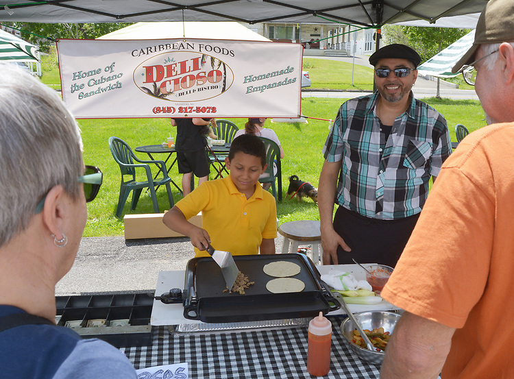Antonio Bruno, working with his father, Chef-Owner, Roberto Bruno, at the Deli-cios0 Deli and Bistro booth, at the Saugerties Farmer's Market on Main Street in the Village of Saugerties, NY, on Saturday, June 10, 2017. Photo by Jim Peppler. Copyright/Jim Peppler-2017.
