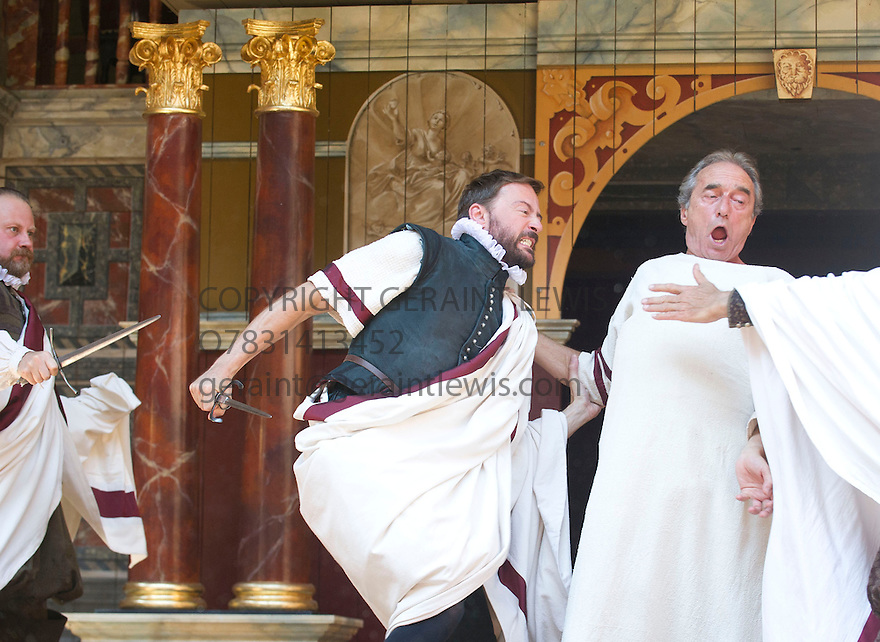 Julius Caesar by William Shakespeare. A Shakespeare's Globe Production directed by Dominic Dromgoogle. With George Irving as Julius Caesar, Anthony Howell as Cassius[ killing Caesar]. Opens at Shakespeare's Globe Theatre on 2/7/14  pic Geraint Lewis