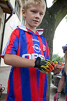 Healthy Polish boy age 8 wearing fingerless bicycle gloves. Rzeczyca Central Poland