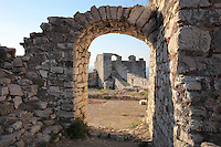 Entrance towers of Berat Castle or Kalaja e Beratit, seen through an arch on a tower inside the citadel, in Berat, South-Central Albania, capital of the District of Berat and the County of Berat. The castle dates mainly from the 13th century and contains Byzantine churches, Ottoman mosques and housing. It is built on a rocky hill on the left bank of the river Osum. Picture by Manuel Cohen