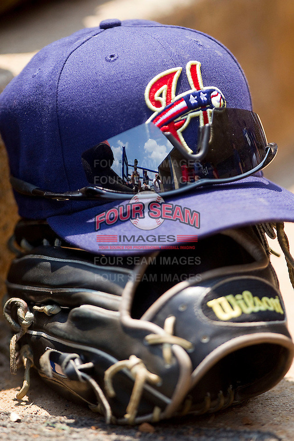 A Harrisburg Senators cap sits on top of a glove in the visitor's dugout during the Eastern League game against the Richmond Flying Squirrels at The Diamond on July 22, 2011 in Richmond, Virginia.  The Squirrels defeated the Senators 5-1.   (Brian Westerholt / Four Seam Images)