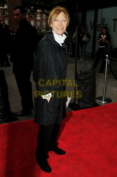 JEAN MARSH .Attending the Press Night for Northern Ballet's 'Cleopatra' at Sadlers Wells, London, England, UK, May 17th 2011..full length black coat side hand in pocket trousers white shirt collar .CAP/CAS.©Bob Cass/Capital Pictures.