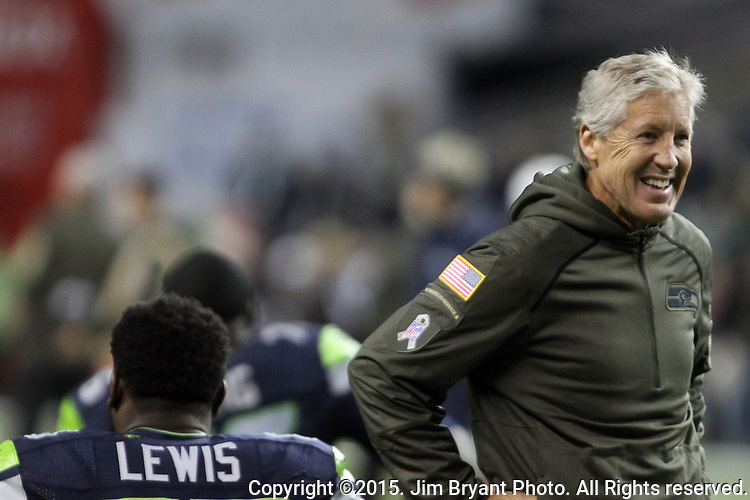 Seattle Seahawks  head coach Pete Carroll talks center Patrick Lewis before their game against the Arizona Cardinals at CenturyLink Field in Seattle, Washington on November 15, 2015. The Cardinals beat the Seahawks 39-32.   ©2015. Jim Bryant photo. All Rights Reserved.