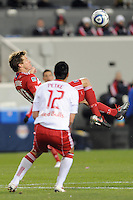 Mike Petke (12) of the New York Red Bulls watches as Brian McBride (20) of the Chicago Fire almost scores on a bicycle kick during the first half of a Major League Soccer match between the New York Red Bulls and the Chicago Fire at Red Bull Arena in Harrison, NJ, on March 27, 2010. The Red Bulls defeated the Fire 1-0.