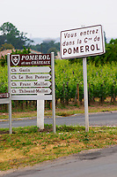 Road sign saying 'Vous entrez dans la commune de Pomerol' (you are entering the commune of Pomerol) and signs pointing to Chateau Gazin, Le Bon Pasteur, Franc Maillet, Thibeaud-Maillet Pomerol Bordeaux Gironde Aquitaine France