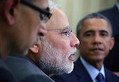 Prime Minister Narendra Modi of India (L) speaks as United States President Barack Obama (R) listens during an Oval Office meeting at the White House, Tuesday, September 30, 2014 in Washington, DC. The two leaders met to discuss the U.S.-India strategic partnership and mutual interest issues. <br /> Credit: Alex Wong / Pool via CNP