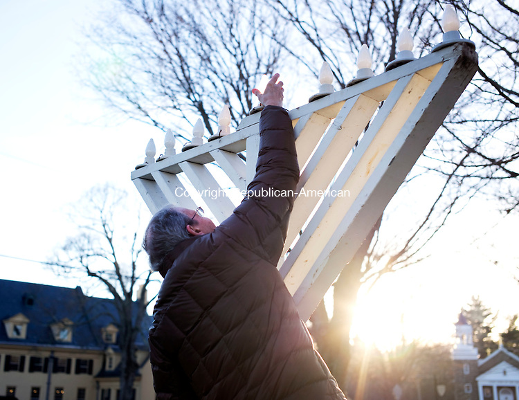 Middlebury, CT- 06 December 2015-120615CM16- Dr. Dick Getnick of Middlebury, lights the Menorah on the Middlebury Green on Sunday.  A group of people from the Middlebury community gathered on the green to celebration the start of Hanukkah, the start of the Jewish holiday, which began on the evening of December 6th.   Christopher Massa Republican-American