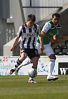 Paul McGowan watched by Thomas Soares in the St Mirren v Hibernian Clydesdale Bank Scottish Premier League match played at St Mirren Park, Paisley on 29.4.12.