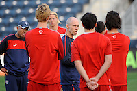 United States (USA) head coach Bob Bradley addresses the team during a practice session at PPL Park in Chester, PA, on October 11, 2010.