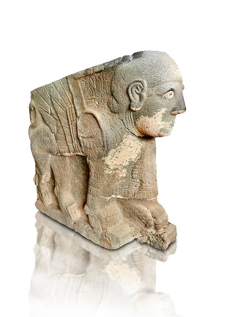 Pictures & images of the North Gate Hittite sculpture statue depicting a mythical winged god with a human head. 8the century BC.  Karatepe Aslantas Open-Air Museum (Karatepe-Aslantaş Açık Hava Müzesi), Osmaniye Province, Turkey. Against white background