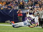 Minnesota Vikings wide receiver Greg Camarillo (85) leaps over the diving tackle of Detroit Lions long snapper Don Muhlbach (48) during an NFL football game in Minneapolis, Minnesota on September 26, 2010. The Vikings won 24-10. (AP Photo/David Stluka)