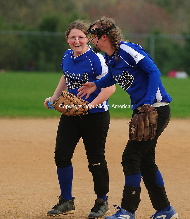 BURLINGTON, CT, 03 MAY 2011-050211JS11-- Lewis Mills' Gina Daniele (21), left, shares a laughwith teammate Amy Powers (72) following their win over Wamogo Tuesday at Lewis S. Mills School in Burlington. <br /> Jim Shannon/Republican-American