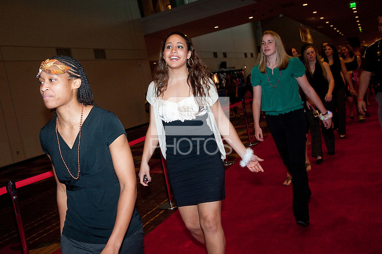 INDIANAPOLIS, IN - APRIL 1, 2011: Melanie Murphy, Grace Mashore and Mikaela Ruef walk the red carpet at the Indianapolis Convention Center at Tourney Town during the NCAA Final Four in Indianapolis, IN on April 1, 2011.