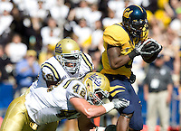 Jeremy Ross of California runs the ball after caught a pass from Kevin Riley during the game against UCLA at Memorial Stadium in Berkeley, California on October 9th, 2010.   California defeated UCLA, 35-7.