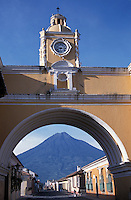 Guatemala, Antigua, Volcan Agua seen through the Arch of Santa Catalina