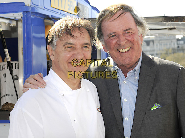 Raymond Blanc & Terry Wogan.being filmed for the BBC at the Real Food Festival, Southbank, London, UK, May 3rd 2013..portrait headshot white chef smiling grey gray blue shirt jacket .CAP/PP/BK.©Bob Kent/PP/Capital Pictures