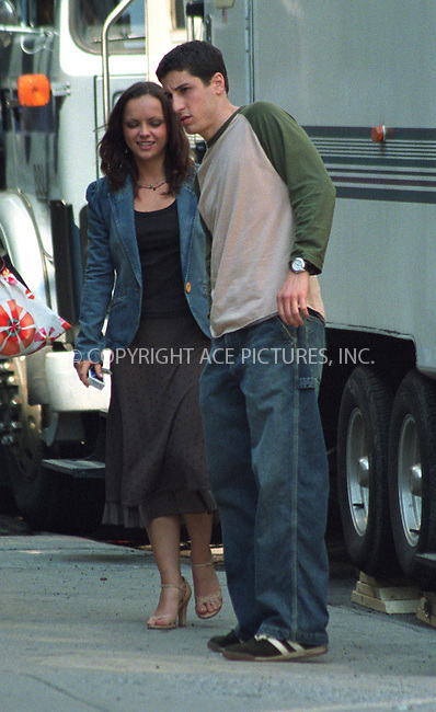"Christina Ricci and Jason Biggs on the set of Woody Allen's film which has a project title ""Anything Else"" or ""Woody Allen's Summer 2002 Project"" in West Village in New York. June 19, 2002. Please byline: Alecsey Boldeskul/NY Photo Press.   ..*PAY-PER-USE*      ....NY Photo Press:  ..phone (646) 267-6913;   ..e-mail: info@nyphotopress.com"