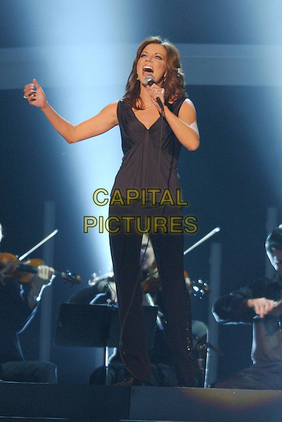 "MARTINA McBRIDE.Performs ""Anyway"".40th Annual CMA Awards held at Gaylord Entertainment Center, Nashville, Tennessee, USA..November 6th, 2006.Ref: ADM/LF.full length stage concert gig performance music singing   microphone.www.capitalpictures.com.sales@capitalpictures.com.©Laura Farr/AdMedia/Capital Pictures."