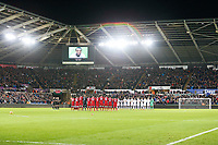 A minutes applause takes place in memory of Cyrille Regis prior to kick off of the Premier League match between Swansea City and Liverpool at the Liberty Stadium, Swansea, Wales, UK. Monday 22 January 2018