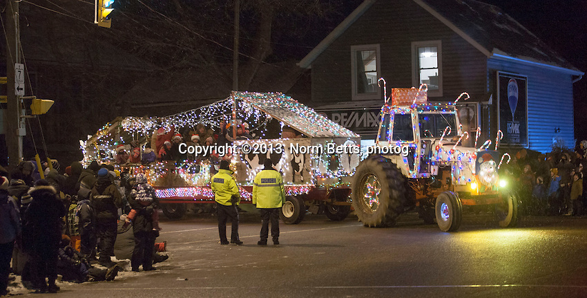 FARMERS' SANTA PARADE  -- ROCKWOOD, Ontario, Canada, 12 Dec.'13. <br /> For the past 20 years farmers surrounding the town of Rockwood, 80 Km northwest of Toronto, had decorated their farm machinery for the town Christmas season Santa parade&hellip; combine harvesters, tractors of every make and model, reapers, seed drills, even manure spreaders&hellip; covered with lights, tinsel and happy farm families parade through town<br /> <br /> photo by Norm Betts<br /> 416 460 8743<br /> normbetts@canadianphotographer.com<br /> &copy;2013, Norm Betts, photographer