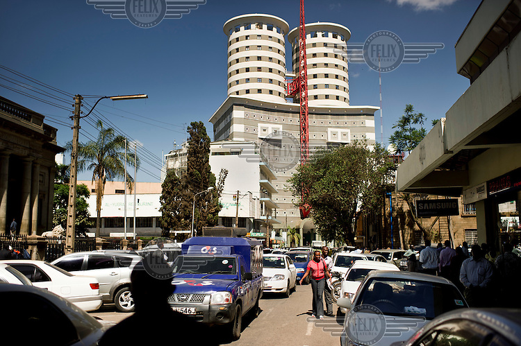 Traffic on a street outside the headquarters of the Daily Nation newspaper.