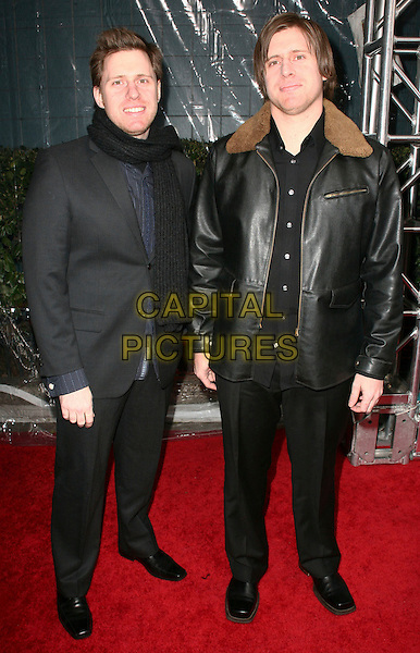"PETER & MICHAEL SPIERIG.Attending the New York City Premiere of ""Daybreakers"" held at the SVA Theater, New York, NY, USA, 7th January 2010..full length black coat leather jacket scarf brown collar suit.CAP/ADM/PZ.©Paul Zimmerman/AdMedia/Capital Pictures."