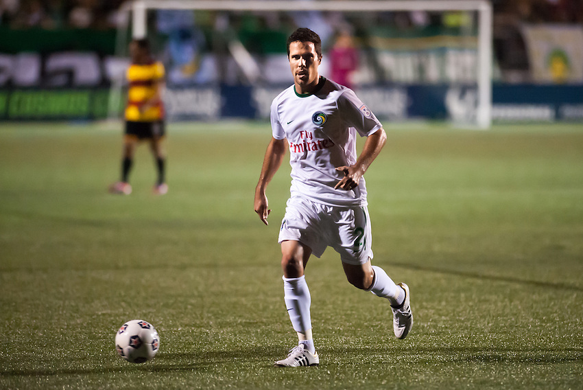 HEMPSTEAD, NY - AUGUST 3: Defender Hunter Freeman of the New York Cosmos dribbles upfield during the Cosmos' home opener against the Fort Lauderdale Strikers on August 3, 2013 at Hofstra University's Shuart Stadium in Hempstead, NY.