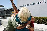 San Diego, CA, Saturday, September 06 2008:  Friends of Rosa Lisowski embrace after a press conference at Barnard Elementary School to comment on the arrest of her husband, Henry.   Lisowski was arrested at his home in Ocean Beach last Friday night.  Rosa Lisowski has not been seen since she dropped her son off at the Barnard Elemtary school on the morning of Monday March 24 2008.  From left, Heather Peterson, Arthur Eischens, Cheryl Eischens, Janet Boyd.