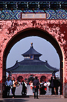 People pass under the gateway entrance to the Temple of Heavenly Peace. Beijing, China.