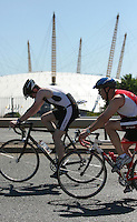 04 AUG 2007 - LONDON, UK - Age group competitors cycle past the Millenium Dome - London Triathlon. (PHOTO (C) NIGEL FARROW)