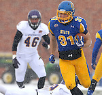BROOKINGS, SD - NOVEMBER 15: Zach Zenner #31 from South Dakota State University breaks loose past Luke Venegoni #46 from Western Illinois for a touchdown in the first quarter Saturday afternoon at Coughlin Alumni Stadium in Brookings. (Photo by Dave Eggen/Inertia)