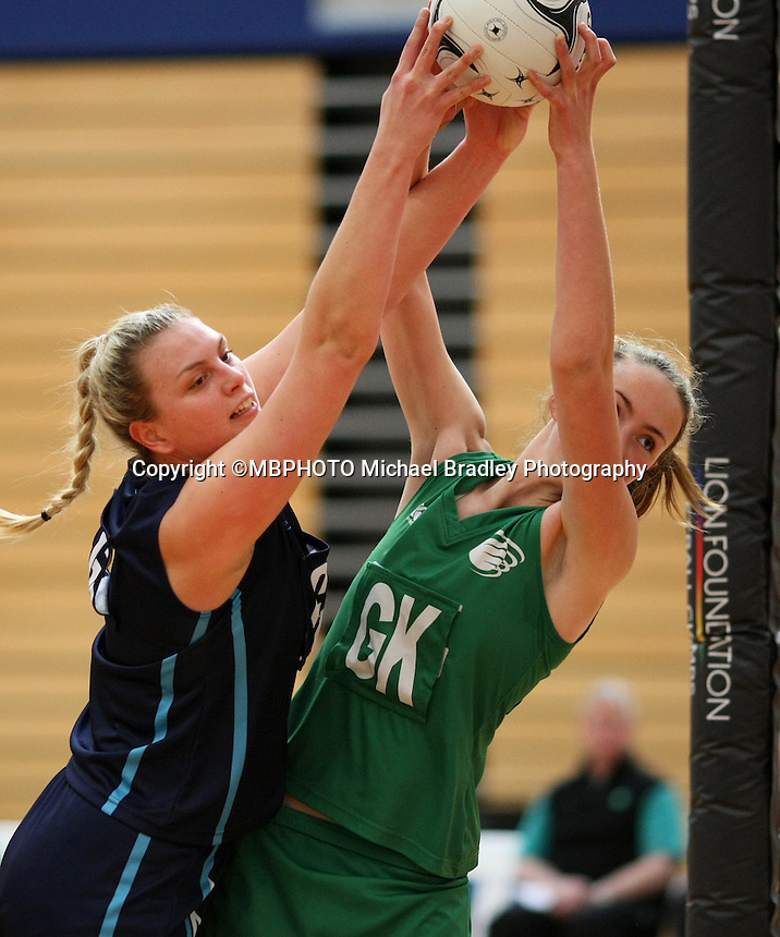 Hamilton's Elsa Brown, left, and Manawatu's  Kelly Jury compete for the ball in the Lion Foundation Netball Championship match, day one, MoreFM Arena, Dunedin, New Zealand, Monday, September 30, 2013.Credit: Dianne Manson/©MBPHOTO /Michael Bradley Photography.