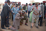OTJIWARONGO, NAMBIA- AUGUST 12: A Herero elder spits water in the faces of newly arrived Herero veterans  during a march when commemorating fallen chiefs killed in battles with Germans. The blessing ceremony is held to welcome the arrival of the members of the community. The area was the venue for decisive battles of the Herero uprisings in 1904. The Herero accuse the German Empire of Genocide of its people from 1904-07. They are currently trying to make the German government compensate the descendants of the people killed. (Photo by Per-Anders Pettersson)