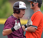 Belleville West's J.B.. Bierman (left) whoops it up after reaching second base. At right is Edwardsville catcher Jacob Kitchen. Edwardsville defeated Belleville West in a semifinal of the Class 4A Bloomington boys baseball sectional which was played in O'Fallon, IL on Wednesday May 29, 2019.<br /> Tim Vizer/Special to STLhighschoolsports.com