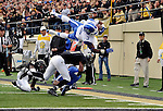 NASHVILLE, TN - NOVEMBER 16: Running back  Jojo Kemp #3 of the Kentucky Wildcats dives over the defense of the Vanderbilt Commodores at Vanderbilt Stadium on November 16, 2013 in Nashville, Tennessee.  (Photo by Frederick Breedon/Getty Images)
