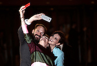 From left: British actor Ralph Fiennes take a selfie with British actress Kristin Scott Thomas and French actress Juliette Binoche on the red carpet as they arrive for the screening of the movie &quot;The English Patient&quot; during the international Rome Film Festival at Rome's Auditorium, 22 October 2016. The Film Festival celebrates one of the most beloved of Cinema History 'The English Patient' by Anthony Minghella, released twenty years ago (in 1996). <br /> UPDATE IMAGES PRESS/Isabella Bonotto