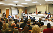 Mildred Muhammad, right at witness stand, ex-wife, of convicted sniper John Allen Muhammad, seated far left, answers questions of Prince William County Commonwealth Attorney Paul S. Ebert, standing, center, as she begins her testimony in the penalty phase of the trial in Virginia Beach Circuit Court in Virginia Beach, Virginia on November 19, 2003.  Now in the punishment phase of the trial, the jury can only choose execution or life in prison without parole for Muhammad, who was found guilty Monday, November 17, 2003 of all charges, including two capital murder counts, in one of 10 fatal shootings that terrorized the Washington, D.C., area in 2002. <br /> Credit: Tracy Woodward - Pool via CNP