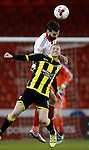 David Edgar of Sheffield Utd tussles with Stuart Beavon of Burton Albion - English League One - Sheffield Utd vs Burton Albion - Bramall Lane Stadium - Sheffield - England - 1st March 2016 - Pic Simon Bellis/Sportimage