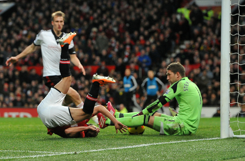 Fulham's Maarten Stekelenburg gathers the ball in front of Manchester United's Rafael<br /> <br /> Photo by Dave Howarth/CameraSport<br /> <br /> Football - Barclays Premiership - Manchester United v Fulham - Sunday 9th February 2014 - Old Trafford - Manchester<br /> <br /> &copy; CameraSport - 43 Linden Ave. Countesthorpe. Leicester. England. LE8 5PG - Tel: +44 (0) 116 277 4147 - admin@camerasport.com - www.camerasport.com